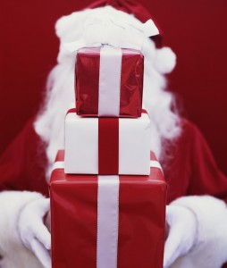 Santa Holding Stack of Gifts --- Image by © Royalty-Free/Corbis
